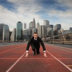 Businessman starting new venture, on a race track toward his new path (the photo is analogy)